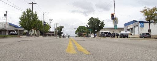 "In this May 10, 2017, photo, shows a street in downtown Blanding, Utah. The rural Utah city, one of the last ""dry"" communities in the Mormon-majority state, will ask voters Tuesday whether to allow beer and wine sales in town for the first time in more than 80 years. (Michelle L. Price/Associated Press)"