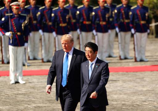 President Donald Trump and Japan Prime Minister Shinzo Abe participate in an honor guard ceremony at the Akasaka Palace, Monday, Nov. 6, 2017, in Tokyo. Trump is on a five country trip through Asia traveling to Japan, South Korea, China, Vietnam and the Philippines.