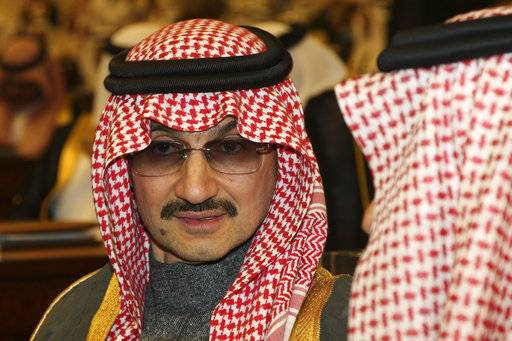 "FILE- In this Sunday, March 7, 2010 file photo, Saudi billionaire Prince Alwaleed bin Talal al-Saud attends the speech of King Abdullah bin Abdul Aziz al-Saud of Saudi Arabia, at the Saudi Shura ""consultative"" council in Riyadh, Saudi Arabia.  Saudi Arabia has arrested dozens of princes and former government ministers, including a well-known billionaire with extensive holdings in Western companies, as part of a sweeping anti-corruption probe, further cementing King Salman and his crown prince son's control of the kingdom. A high-level employee at Prince Alwaleed bin Talal's Kingdom Holding Company told The Associated Press that the royal was among those detained overnight Saturday, Nov. 4, 2017."