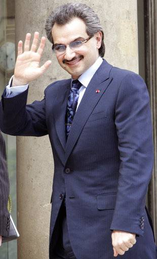 FILE - In this July 16, 2008 file photo, Saudi Prince Alwaleed Bin Talal waves at the Elysee Palace prior to lay the cornerstone of the new Islamic art rooms of the Louvre museum in Paris.  Saudi Arabia has arrested dozens of princes and former government ministers, including a well-known billionaire with extensive holdings in Western companies, as part of a sweeping anti-corruption probe, further cementing King Salman and his crown prince son's control of the kingdom. A high-level employee at Prince Alwaleed bin Talal's Kingdom Holding Company told The Associated Press that the royal was among those detained overnight Saturday, Nov. 4, 2017.