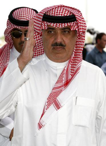 FILE - In this Oct. 23, 2008 file photo, Prince Miteb bin Abdul Aziz, son of Saudi King Abdullah bin Abdul Aziz al-Saud, salutes as leaves the equestrian club following a horse racing competition in Janadriyah in the outskirts of the Saudi capital Riyadh, Saudi Arabia. The king ousted one of the country's highest-level royals from power, relieving Prince Miteb bin Abdullah of his post as head of the National Guard.