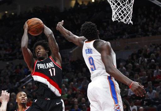 Portland Trail Blazers forward Ed Davis, left, pulls down a rebound against Oklahoma City Thunder forward Jerami Grant during the first half of an NBA basketball game in Portland, Ore., Sunday, Nov. 5, 2017.
