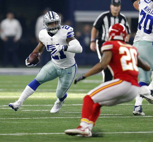 Dallas Cowboys' Ezekiel Elliott (21) looks for running room as Kansas City Chiefs' Steven Nelson (20) gives chase in the first half of an NFL football game, Sunday, Nov. 5, 2017, in Arlington, Texas.