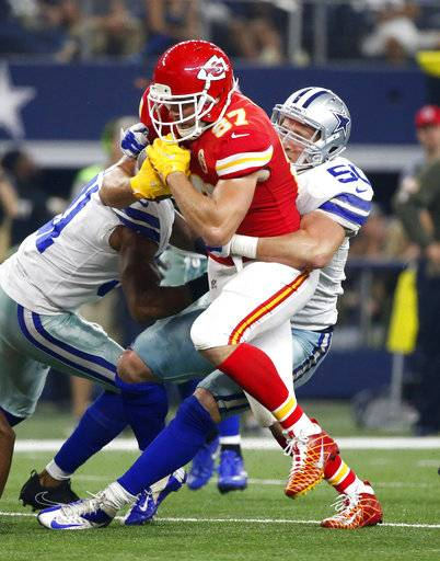 Kansas City Chiefs tight end Travis Kelce (87) fights for extra yardage after catching a pass as Dallas Cowboys linebacker Sean Lee (50) makes the stop in the second half of an NFL football game, Sunday, Nov. 5, 2017, in Arlington, Texas.