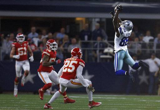 Dallas Cowboys wide receiver Dez Bryant (88) reaches up to catch a pass as Kansas City Chiefs' Derrick Johnson (56) and Kenneth Acker (25) defend in the first half of an NFL football game, Sunday, Nov. 5, 2017, in Arlington, Texas.