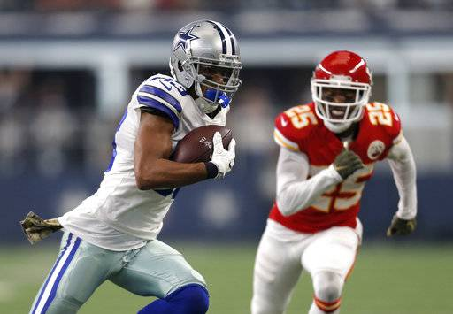Dallas Cowboys wide receiver Terrance Williams (83) carries the ball after catching a pass as Kansas City Chiefs cornerback Kenneth Acker (25) gives chase in the first half of an NFL football game, Sunday, Nov. 5, 2017, in Arlington, Texas.