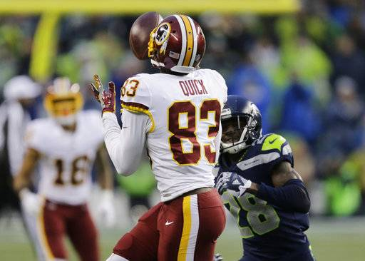 Washington Redskins wide receiver Brian Quick makes a catch ahead of Seattle Seahawks cornerback Justin Coleman in the second half of an NFL football game, Sunday, Nov. 5, 2017, in Seattle. The Redskins won 17-14.