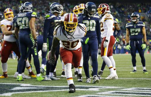 Washington Redskins running back Rob Kelley gets up after scoring a touchdown against the Seattle Seahawks in the second half of an NFL football game, Sunday, Nov. 5, 2017, in Seattle. The Redskins won 17-14.