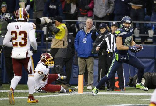 Seattle Seahawks tight end Luke Willson, right, scores a touchdown against the Washington Redskins in the second half of an NFL football game, Sunday, Nov. 5, 2017, in Seattle.