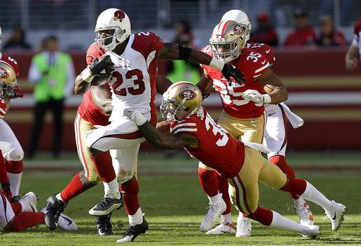 Arizona Cardinals running back Adrian Peterson (23) runs against the San Francisco 49ers during the first half of an NFL football game in Santa Clara, Calif., Sunday, Nov. 5, 2017.