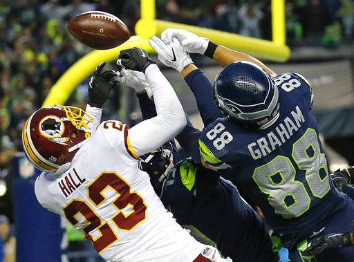 Washington Redskins free safety DeAngelo Hall (23) breaks up a pass in the end zone intended for Seattle Seahawks tight end Jimmy Graham (88) at the end of an NFL football game, Sunday, Nov. 5, 2017, in Seattle. Washington won 17-14.