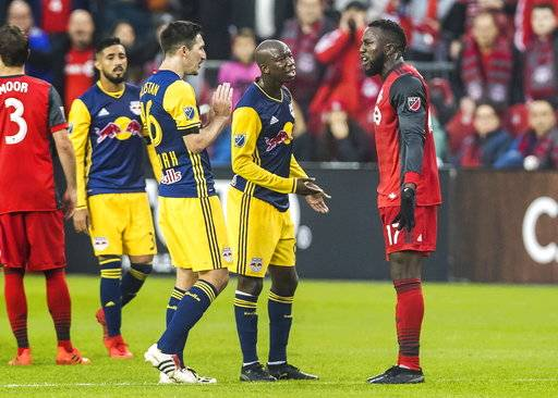Toronto FC forward Jozy Altidore (17) exchanges words with New York Red Bulls midfielder Sacha Kljestan (16) and Bradley Wright-Phillips during first-half MLS soccer game action in Toronto, Sunday, Nov. 5, 2017. (Mark Blinch/The Canadian Press via AP)