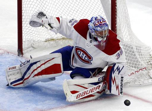 Montreal Canadiens goalie Charlie Lindgren blocks a shot against the Chicago Blackhawks during the second period of an NHL hockey game, Sunday, Nov. 5, 2017, in Chicago.