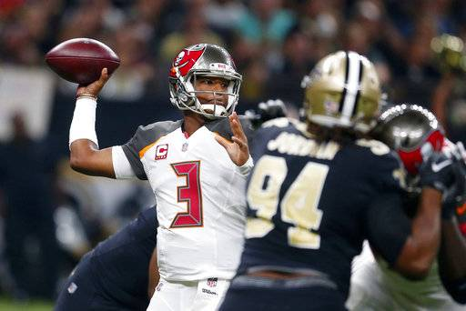 Tampa Bay Buccaneers quarterback Jameis Winston (3) passes under pressure from New Orleans Saints defensive end Cameron Jordan (94) in the first half of an NFL football game in New Orleans, Sunday, Nov. 5, 2017.