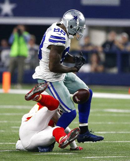 Dallas Cowboys wide receiver Dez Bryant (88) drops a pass as Kansas City Chiefs' Ron Parker (38) rolls onto Bryant's ankle in the second half of an NFL football game, Sunday, Nov. 5, 2017, in Arlington, Texas.