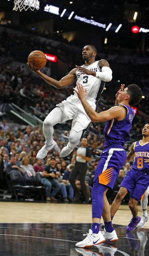 After a steal San Antonio Spurs' Brandon Paul(3) drives for two as Phoenix Suns Devin Booker watches in a NBA game on Sunday, Nov. 5, 2017 in San Antonio.