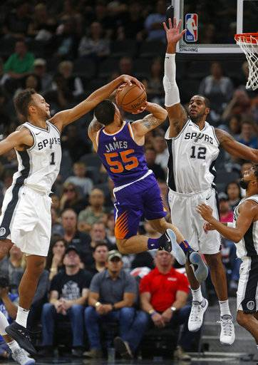 San Antonio Spurs' Kyle Anderson(1) blocks a shot attempt by Phoenix Suns' Mike James(55) during the first half of an NBA game on Sunday, Nov. 5, 2017 in San Antonio.