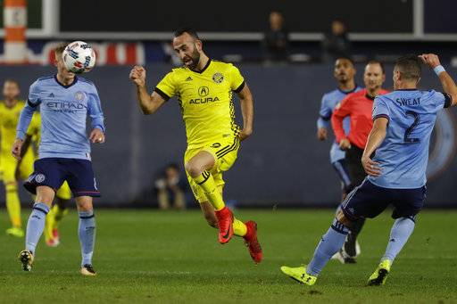 Columbus Crew's Justin Meram (9) is defended by New York City FC's Ben Sweat (2) during the first half of an MLS Eastern Conference semifinal soccer match Sunday, Nov. 5, 2017, in New York.