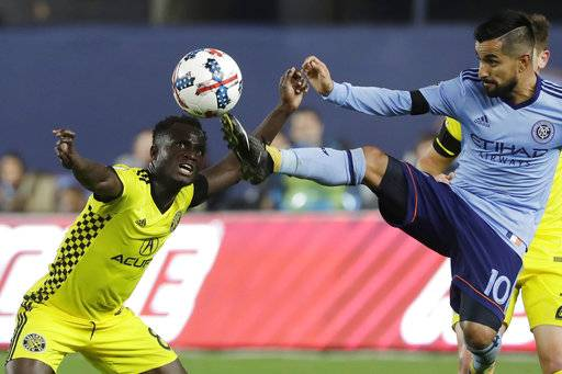 New York City FC's Maximiliano Moralez (10) kicks the ball away from Columbus Crew's Mohammed Abu (8) in the second half of an MLS Eastern Conference semifinal soccer match, Sunday, Nov. 5, 2017, in New York. New York City FC won 2-0, but the Crew won the two-game match on aggregate score and advances to the conference championship.
