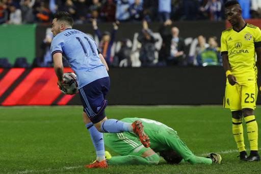 New York City FC's Jack Harrison (11) collects the ball from the goal after Columbus Crew's goaltender Zack Steffen (23) gave up an own-goal in the second half of an MLS Eastern Conference semifinal soccer match Sunday, Nov. 5, 2017, in New York.