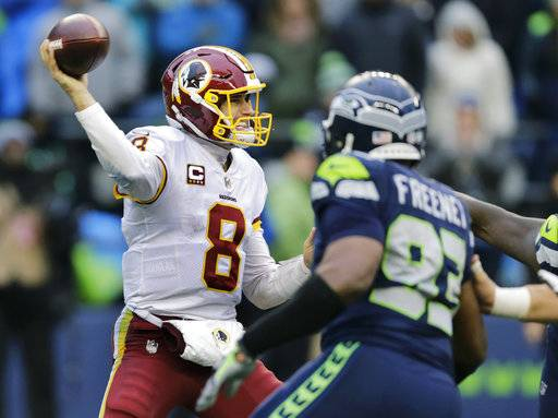 Washington Redskins quarterback Kirk Cousins passes under pressure from Seattle Seahawks defensive end Dwight Freeney (93) in the second half of an NFL football game, Sunday, Nov. 5, 2017, in Seattle.