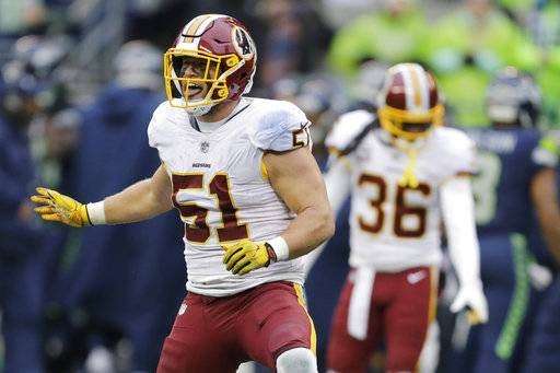 Washington Redskins inside linebacker Will Compton celebrates after he intercepted a pass in the second half of an NFL football game against the Seattle Seahawks, Sunday, Nov. 5, 2017, in Seattle.