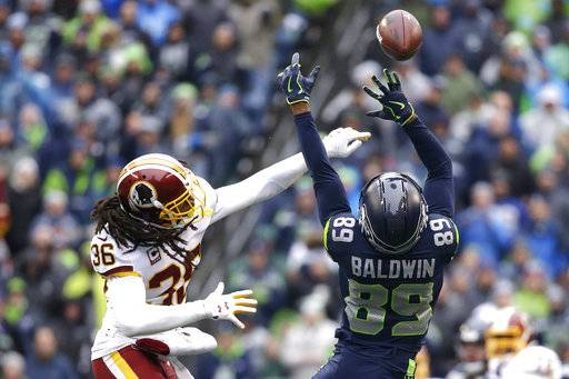 Washington Redskins free safety D.J. Swearinger, left, breaks up a pass intended for Seattle Seahawks wide receiver Doug Baldwin (89) in the first half of an NFL football game, Sunday, Nov. 5, 2017, in Seattle.