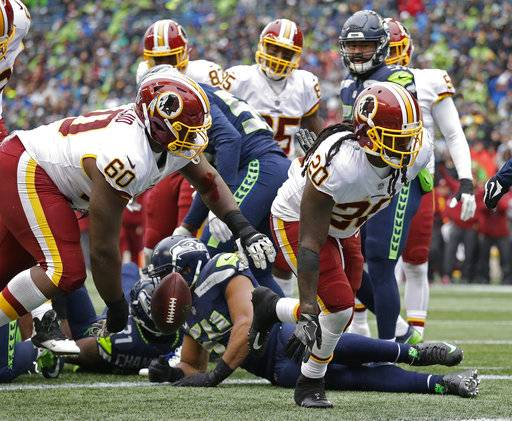 Washington Redskins running back Rob Kelley (20) gets up after he scored a 1-yard rushing touchdown against the Seattle Seahawks in the first half of an NFL football game, Sunday, Nov. 5, 2017, in Seattle.