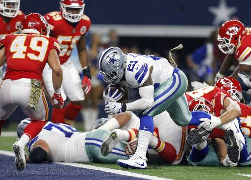 Kansas City Chiefs' Daniel Sorensen (49) defends as Dallas Cowboys' Ezekiel Elliott (21) sprints into the end zone for a touchdown in the second half of an NFL football game, Sunday, Nov. 5, 2017, in Arlington, Texas.