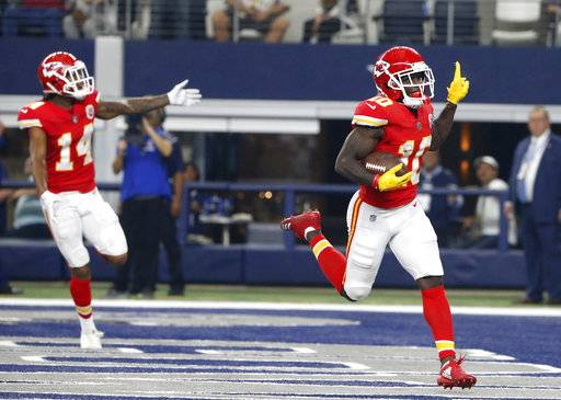 Kansas City Chiefs' Demarcus Robinson (14) and Tyreek Hill (10) celebrate a long touchdown run by Hill late in the first half of an NFL football game against the Dallas Cowboys on Sunday, Nov. 5, 2017, in Arlington, Texas.