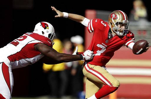 San Francisco 49ers quarterback C.J. Beathard, right, runs from Arizona Cardinals defensive tackle Olsen Pierre during the first half of an NFL football game in Santa Clara, Calif., Sunday, Nov. 5, 2017.