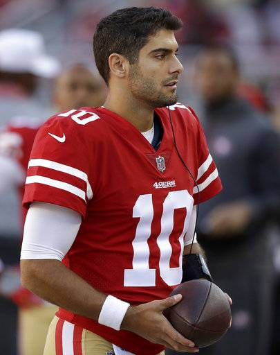 San Francisco 49ers quarterback Jimmy Garoppolo (10) watches from the sideline during the second half of an NFL football game against the Arizona Cardinals in Santa Clara, Calif., Sunday, Nov. 5, 2017.