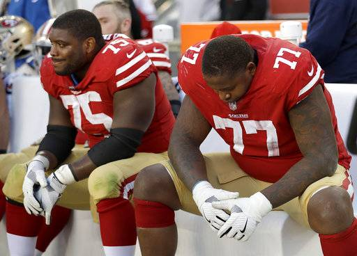 San Francisco 49ers offensive guard Laken Tomlinson (75) and offensive tackle Trent Brown (77) sit on the bench during the second half of an NFL football game against the Arizona Cardinals in Santa Clara, Calif., Sunday, Nov. 5, 2017.