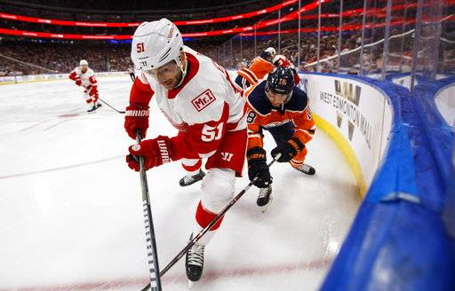 Detroit Red Wings' Frans Nielsen (51) and Edmonton Oilers' Ryan Strome (18) vie for the puck during first-period NHL hockey game action in Edmonton, Alberta, Sunday, Nov. 5, 2017. (Jason Franson/The Canadian Press via AP)