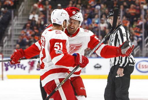 Detroit Red Wings' Niklas Kronwall (55) and teammate Frans Nielsen (51) celebrate a goal during first-period NHL hockey game action against the Edmonton Oilers in Edmonton, Alberta, Sunday, Nov. 5, 2017. (Jason Franson/The Canadian Press via AP)