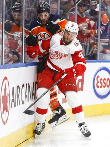 Detroit Red Wings' Luke Glendening (41) checks Edmonton Oilers' Eric Gryba (62) during first-period NHL hockey game action in Edmonton, Alberta, Sunday, Nov. 5, 2017. (Jason Franson/The Canadian Press via AP)