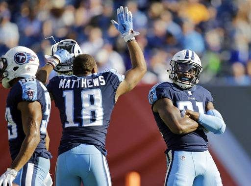 Tennessee Titans wide receiver Rishard Matthews (18) celebrates with free safety Kevin Byard (31) after Byard made his second pass interception of the game against the Baltimore Ravens in the second half of an NFL football game Sunday, Nov. 5, 2017, in Nashville, Tenn.