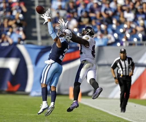 CORRECTS TO REMOVE SCORE - Tennessee Titans free safety Kevin Byard (31) intercepts a pass intended for Baltimore Ravens tight end Benjamin Watson (82) in the second half of an NFL football game Sunday, Nov. 5, 2017, in Nashville, Tenn.