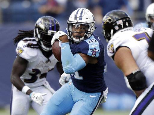 Tennessee Titans free safety Kevin Byard (31) runs back a pass interception against the Baltimore Ravens in the first half of an NFL football game Sunday, Nov. 5, 2017, in Nashville, Tenn.