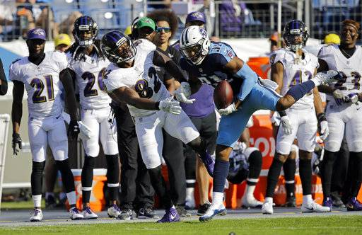 Tennessee Titans free safety Kevin Byard (31) intercepts a pass intended for Baltimore Ravens tight end Benjamin Watson (82) in the second half of an NFL football game Sunday, Nov. 5, 2017, in Nashville, Tenn. It is the second interception of the game for Byard.