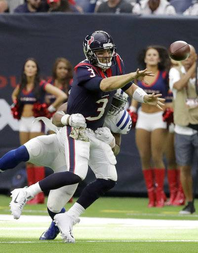 Houston Texans quarterback Tom Savage (3) tosses the ball as he is hit by Indianapolis Colts inside linebacker Jon Bostic (57) during the second half of an NFL football game Sunday, Nov. 5, 2017, in Houston.