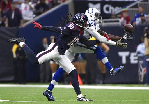 Indianapolis Colts cornerback Pierre Desir (35) breaks up a pass intended for Houston Texans wide receiver DeAndre Hopkins (10) during the half of an NFL football game Sunday, Nov. 5, 2017, in Houston.