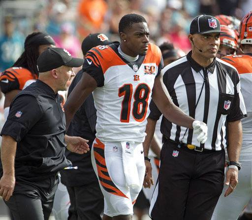 Cincinnati Bengals wide receiver A.J. Green (18) is escorted off the field after he was involved in an altercation with players from the Jacksonville Jaguars during the first half of an NFL football game, Sunday, Nov. 5, 2017, in Jacksonville, Fla.