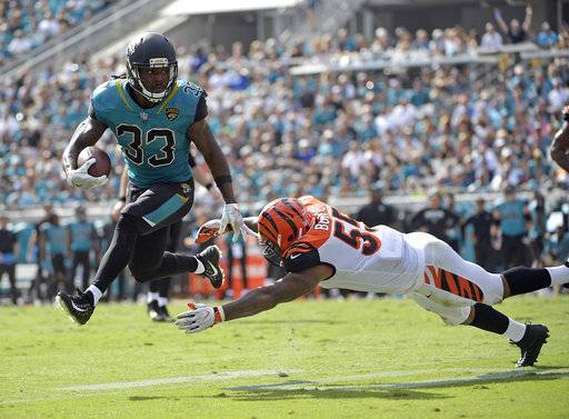 Jacksonville Jaguars running back Chris Ivory (33) makes a move to get around Cincinnati Bengals linebacker Vontaze Burfict during the first half of an NFL football game, Sunday, Nov. 5, 2017, in Jacksonville, Fla.