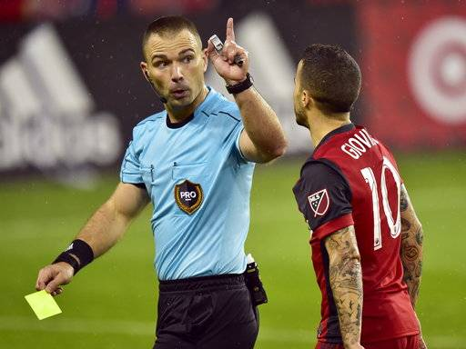 Toronto FC forward Sebastian Giovinco (10) receives a yellow card from the referee during second-half MLS soccer game action against the New York Red Bulls in Toronto, Sunday, Nov. 5, 2017. (Frank Gunn/The Canadian Press via AP)