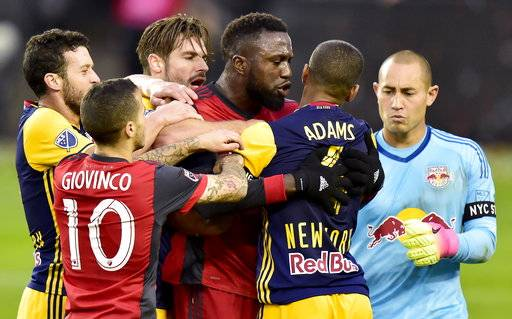 Toronto FC forward Jozy Altidore, third from right, scuffles with New York Red Bulls midfielder Tyler Adams, second from right, after teammate Sebastian Giovinco (10) was pushed to the ground during first-half MLS soccer game action in Toronto, Sunday, Nov. 5, 2017. (Frank Gunn/The Canadian Press via AP)
