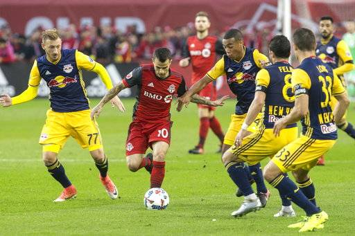 Toronto FC forward Sebastian Giovinco (10) attempts to make his way through a stacked New York Red Bulls defense during first-half MLS soccer game action in Toronto, Sunday, Nov. 5, 2017. (Chris Young/The Canadian Press via AP)