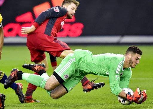 Toronto FC goalkeeper Alex Bono, right, makes a save during first-half MLS soccer game action against the New York Red Bulls in Toronto, Sunday, Nov. 5, 2017. (Frank Gunn/The Canadian Press via AP)