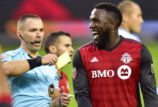 Toronto FC forward Jozy Altidore, right, reacts after receiving a yellow card during first-half MLS soccer game action against the New York Red Bulls in Toronto, Sunday, Nov. 5, 2017. (Frank Gunn/The Canadian Press via AP)Gunn/The Canadian Press via AP)