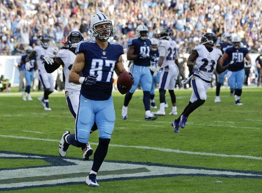 Tennessee Titans wide receiver Eric Decker (87) catches an 11-yard touchdown pass against the Baltimore Ravens in the second half of an NFL football game Sunday, Nov. 5, 2017, in Nashville, Tenn.